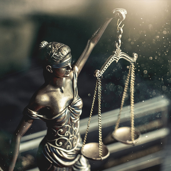 Figure of Blind Justice Holding Scales